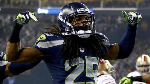 Seattle Seahawk player Richard Sherman celebrates during a 19 January football game.