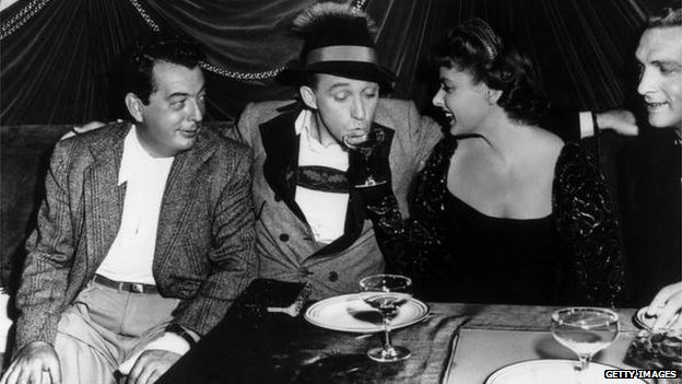 Lewis Milestone, actress Ethel Merman and screenwriter Robert Riskin, shown here in 1938, at a horse race