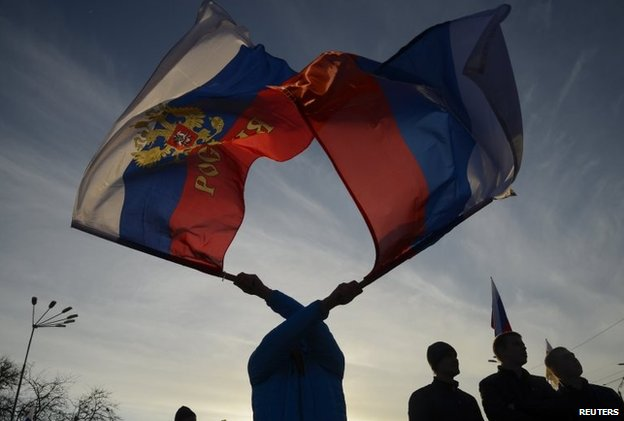 Pro-Russian demonstrators take part in a rally in the Crimean town of Yevpatoria March 5