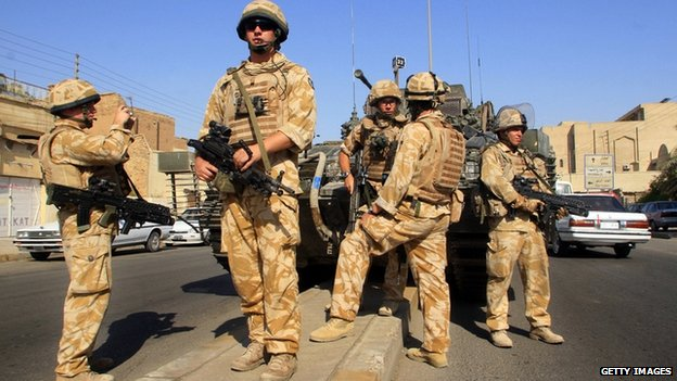 British soldiers patrol a street in the southern city of Basra, Iraq