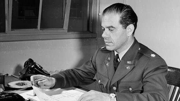 Frank Capra at his desk in the war department