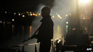 "A Ukrainian sailor guards the Ukrainian Navy ship the ""Slavutych"" blocked in the bay of Sevastopol"