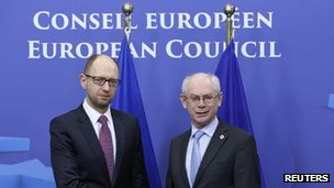 Ukraine's Prime Minister Arseniy Yatsenyuk (left) is welcomed by European Council President Herman Van Rompuy ahead of a European leaders emergency summit