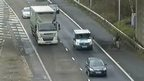 CCTV on 25 February shows the cyclist on the hard shoulder preparing to cross the carriageway