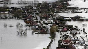 Water surrounds flooded propeties in the village of Moorland on the Somerset Levels