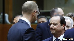 kraine's Prime Minister Arseniy Yatsenyuk (left) talks to French President Francois Hollande during the emergency summit of European leaders on Ukraine being held in Brussels