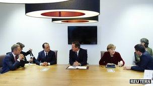 Polish PM Donald Tusk (left to right), French President Francois Hollande, British PM David Cameron, German Chancellor Angela Merkel and Italian PM Matteo Renzi meet ahead of a European leaders emergency summit on Ukraine, in Brussels