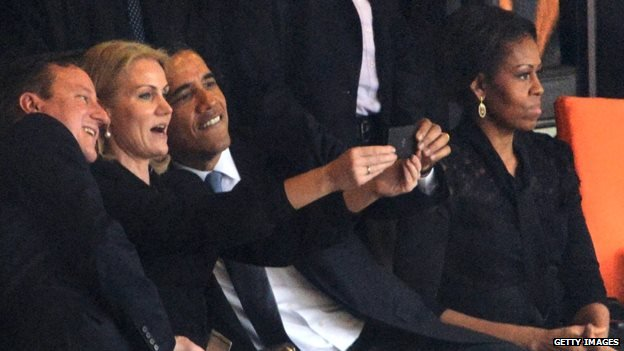 US President Barack Obama, UK Prime Minister David Cameron, and Denmark's PM Helle Thorning-Schmidt take an impromptu photograph of themselves at the memorial service for the late South African President Nelson Mandela.