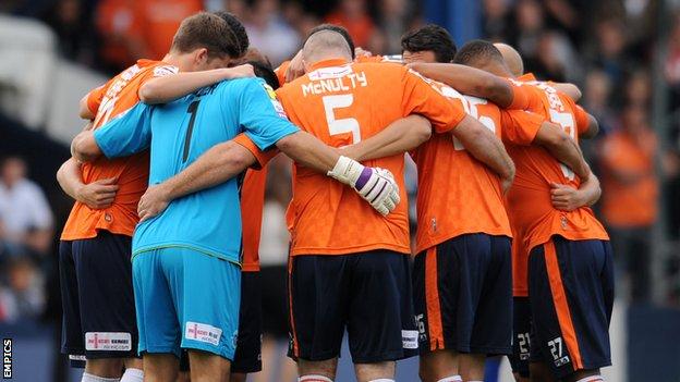 Luton Town team huddle