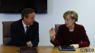 British Prime Minister David Cameron and German Chancellor Angela Merkel meet ahead in Brussels ahead of a European leaders emergency summit on Ukraine