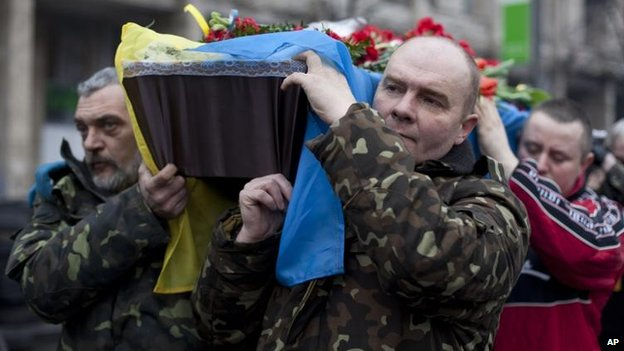 Pallbearers carry the coffin of Andryi Pozniak, killed two days ago near Kiev's Independence Square