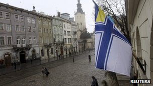 A Ukrainian Naval Forces flag is on display at the city hall building in Lviv, in support of Ukrainian military sailors based in Crimea, on 6 March 2014.
