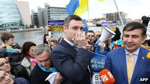 Vitaly Klitschko, (C) leader of Ukraine's UDAR party, addresses a pro-Ukrainian rally with Mikheil Saakashvili (R) former President of Georgia, outside the Dublin Convention Centre in Ireland, on 6 March 6, 2014.