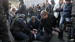 Police detain a pro-Russian demonstrator during a rally at the regional administrative building in Donetsk, Ukraine, on 6 March 2014.