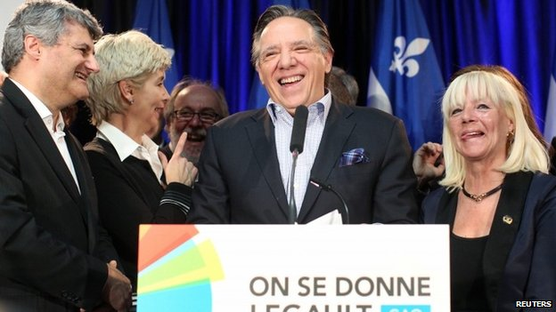 Coalition Avenir Quebec (CAQ) leader Francois Legault smiles during a news conference after Quebec's Premier Pauline Marois called an election in Quebec City 5 March 2014