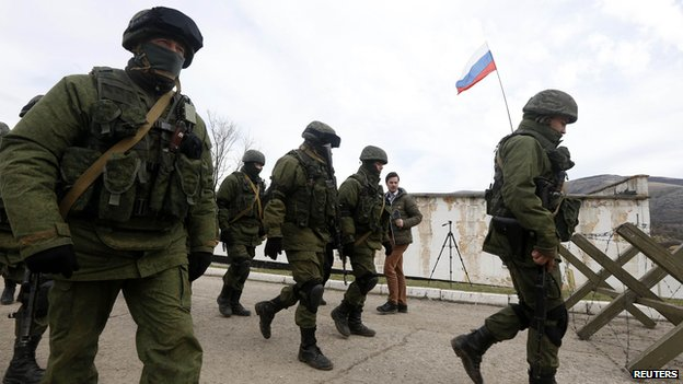 Soldiers outside Perevalnoye 6 March Reuters