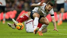 Jack Wilshere is hurt in a tackle by Daniel Agger