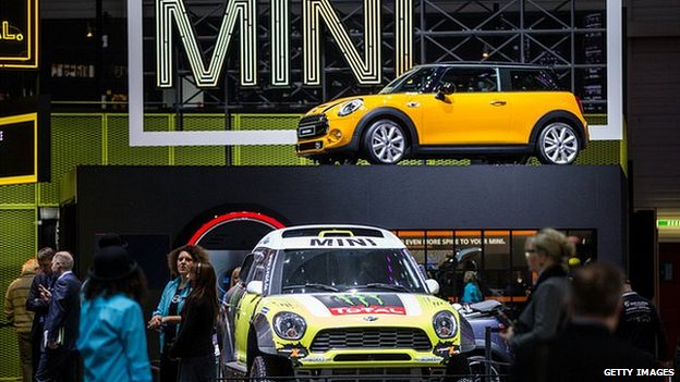 People at the Mini stand at the Geneva motor show 2014