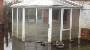 A discoloured conservatory in Moorend shows how the water levels has dropped