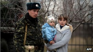 A soldier talks to his family inside the air base in Belbek, not far from Sevastopol on 6 March 2014.