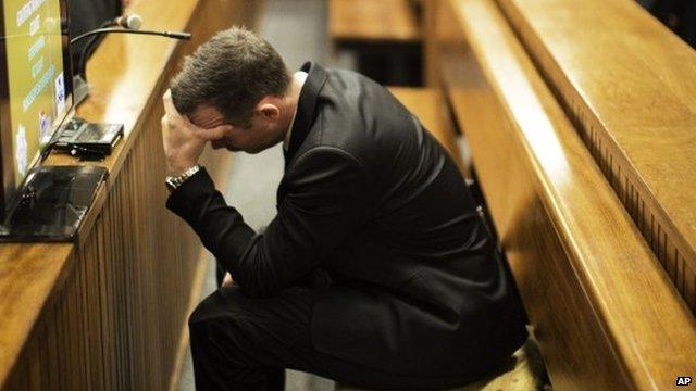 Oscar Pistorius with head in hands