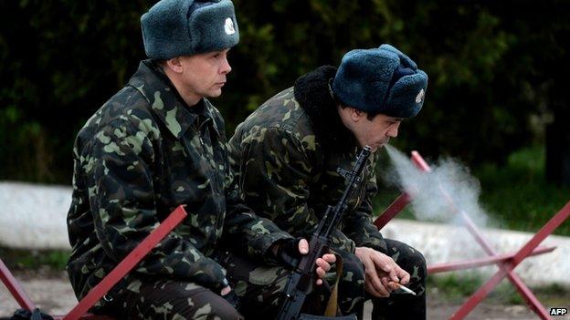 Russian soldiers sit inside the airbase in Belbek, not far from Sevastopol, in Crimea, Ukraine - 6 March 2014
