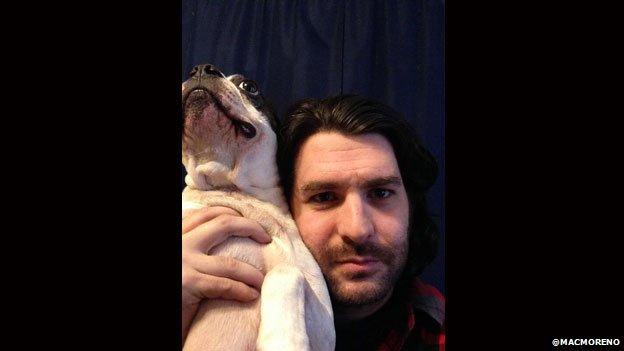Comedian Mac Moreno poses with his dog