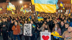 Pro-Ukrainian activists sing the state anthem during a rally in the centre of the eastern Ukrainian city of Kharkiv on 6 March 2014