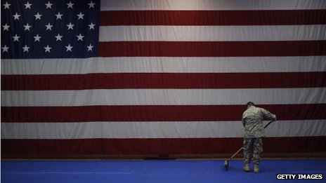 An Army private sweeps the floor in Fort Knox, Kentucky, on 27 February 2014