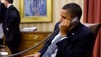 President Barack Obama speakers by phone with Egypt's president Hosni Mubarak