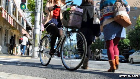 Women are seen on the street in Kyoto, Japan, on 25 October 2012