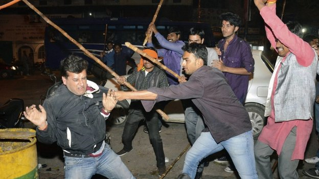 """Supporters of Aam Aadmi (Common Man) Party (AAP) and India""""s main opposition Bharatiya Janata Party (BJP) clash during a protest outside the office of BJP in the northern Indian city of Lucknow March 5, 2014. Street clashes marred an announcement on Wednesday that India""""s general election will start on April 7 as passions run high in a race that pits Hindu nationalist Narendra Modi against the unpopular Nehru-Gandhi family""""s ruling party"""