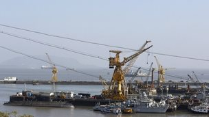 Ships and submarines belonging to the Indian Navy are seen docked at the naval dockyard in Mumbai February 27, 2014.