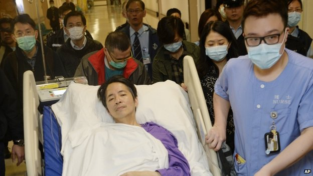 Former Ming Pao chief editor Kevin Lau is transferred to a private ward in a hospital after three days intensive care in Hong Kong Saturday, 1 March 2014