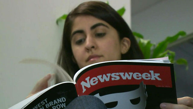 Woman reading new print edition of Newsweek