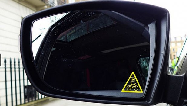 Think Bike sticker in a car wing mirror