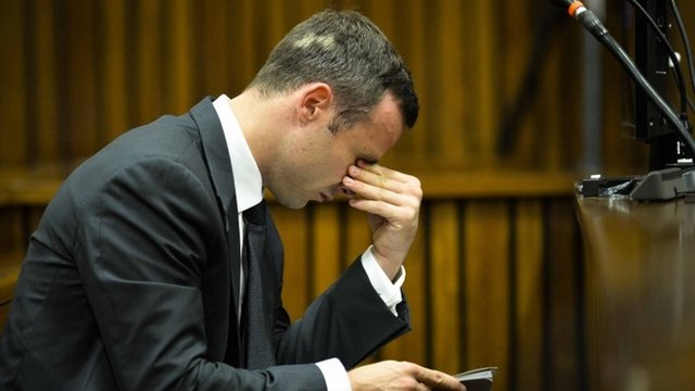 Pistorius 'bashed' door with bat...