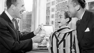 Bruce Forsyth, Archies new tutor, and Archie pay a visit to Peter Broughs office