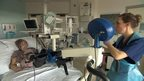Patient using hospital exercise bike