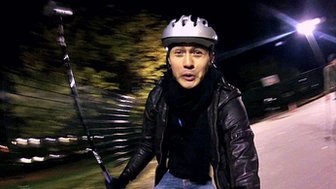 Henry Golding plays bike polo