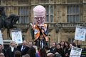 An effigy of Justice Secretary Chris Grayling is held up as barristers and solicitors hold a demonstration outside Parliament