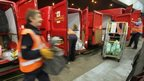 Staff unload vans at Royal Mail's sorting office in Filton