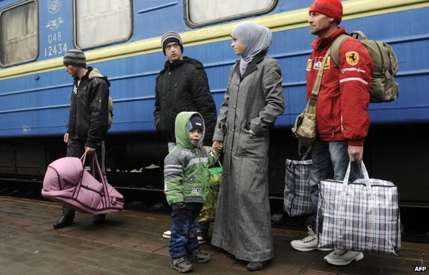 A family of Crimean Tatars disembarks from a train at Lviv (7 March 2014)