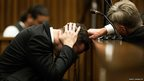 Oscar Pistorius, puts his hands to his head while listening to evidence from a witness