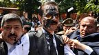The chairman of Sahara India Pariwar, Subrata Roy, his face smeared with ink thrown by a lawyer, walks into the Supreme Court in New Delhi, India