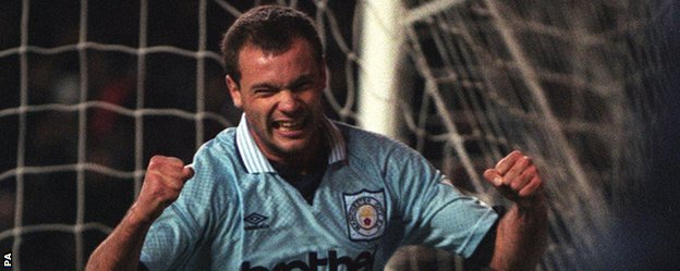 Uwe Rosler celebrates one of his 64 goals for Manchester City