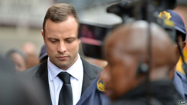 Oscar Pistorius arrives at the court in Pretoria for the third day of his trial