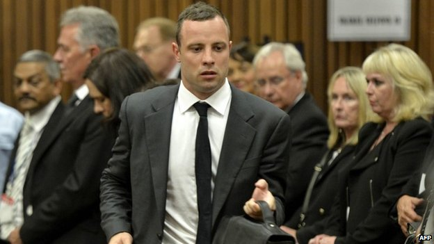 Oscar Pistorius arrives for the opening day of his murder trial