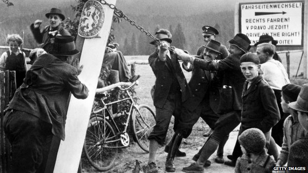 Some inhabitants of Kaplice (Kaplitz) remove the Czechoslovakian border sign on October 04, 1938 on German-Czechoslovakian border.