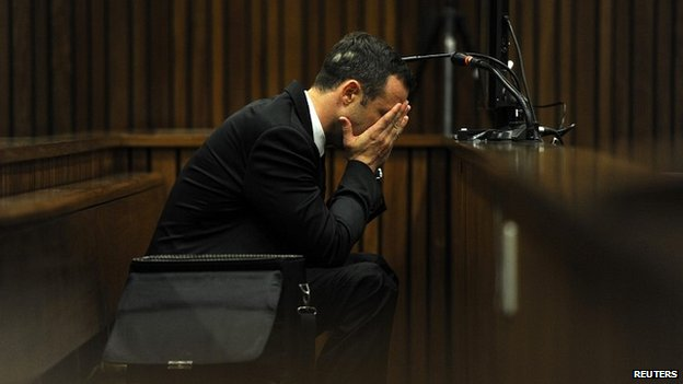 Oscar Pistorius reacts to part of the evidence on the fourth day of his trial